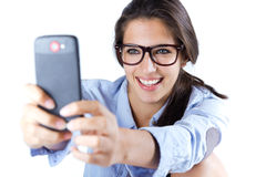 Cute brunette woman taking photo of herself. Isolated Stock Photo