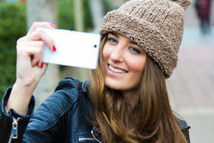 Cute brunette woman taking photo of herself Royalty Free Stock Images