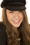 Cute brunette woman wearing a black hat smiling. Cute brunette woman wearing black hat smiling Royalty Free Stock Images