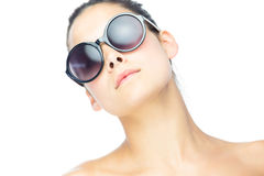 Cute brunette woman wearing gigantic sunglasses Stock Photos