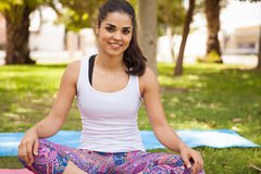 Cute brunette on a yoga mat Royalty Free Stock Images
