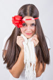 Cute brunette young woman with red bow wearing white scarf Stock Images