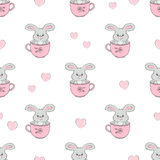 Cute bunnies in cups seamless pattern. Baby print Royalty Free Stock Images