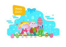 Cute bunnies with an Easter basket and eggs in hand. Royalty Free Stock Photography