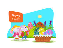 Cute bunnies with an Easter basket and eggs in hand. Royalty Free Stock Photos
