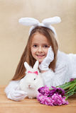 Cute bunnies with spring flowers Royalty Free Stock Images