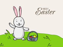 Cute bunny with basket for Happy Easter celebration. Royalty Free Stock Image