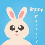 Cute bunny  on a blue background. Text Happy Easter! Stock Photos