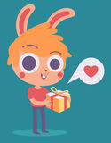 Cute Bunny Boy Holding a Present Royalty Free Stock Images