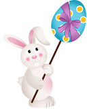 Cute Bunny Carries Easter Egg Stock Image