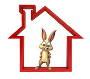 Cute Bunny cartoon character with home sign Royalty Free Stock Image