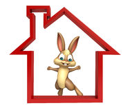Cute Bunny cartoon character with home sign Royalty Free Stock Images