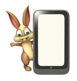 Cute Bunny cartoon character with mobile Royalty Free Stock Photos