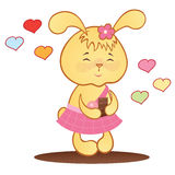 Cute bunny with chocolate and hearts. Stock Images