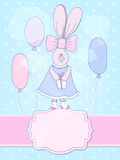 Cute bunny-girl in a dress with a bow. Royalty Free Stock Images