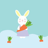 Cute bunny holding a carrot Stock Images
