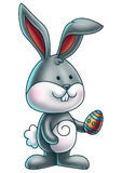 Cute Bunny Holding an Easter Egg 1 Stock Photo