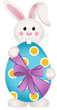 Cute bunny holding an Easter egg Royalty Free Stock Images