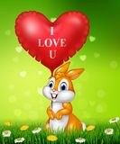 Cute bunny holding red heart balloons on green grass. Illustration of Cute bunny holding red heart balloons on green grass Royalty Free Stock Photo