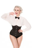 Cute burlesque dancer strikes a pose, dressed in bow tie, frille Stock Images