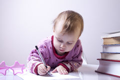 Cute business child girl signs a contract. Business, agreement, Royalty Free Stock Photography