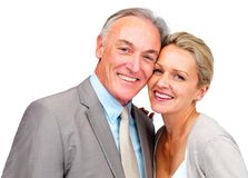 Cute business couple smiling together on white Royalty Free Stock Images