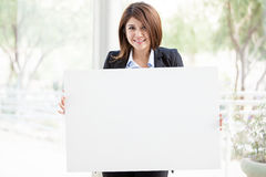 Cute business girl holding a sign Stock Images