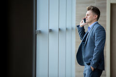 Cute business man in a strict black suit Royalty Free Stock Image