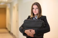 Cute business woman hold a notebook bag Stock Photography