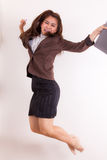 Cute business woman jumping Stock Photos
