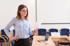 Cute business woman read a document Stock Photos