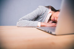 Cute business woman sleeping on the table Royalty Free Stock Photography