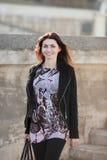 Cute business woman walks outside Stock Image
