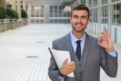 Cute businessman giving an OK sign.  Stock Image