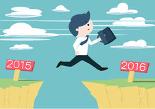 Cute businessman jump across the cliff from year 2015 to year 2016. Stock Photo