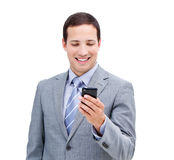 Cute businessman looking at his phone Royalty Free Stock Photos