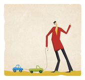 Cute businessman walking with toy cars Royalty Free Stock Images