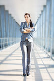 Cute businesswoman on the blue modern background Stock Image
