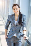 Cute businesswoman on the blue modern background Stock Photos