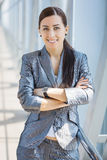 Cute businesswoman on the blue modern background Royalty Free Stock Images