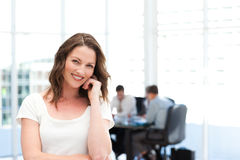 Cute businesswoman in front of her teamwork Royalty Free Stock Photography
