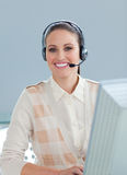 Cute businesswoman with headset on Royalty Free Stock Photo