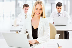 Cute businesswoman in an office Stock Images