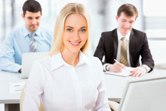 Cute businesswoman in an office Stock Photo