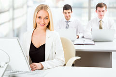 Cute businesswoman in an office Royalty Free Stock Images