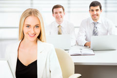 Cute businesswoman in an office Royalty Free Stock Photo