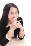 Cute businesswoman (Office Lady) smiles with pen Stock Images