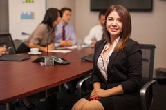 Cute businesswoman in an office Royalty Free Stock Photos