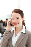Cute businesswoman on the phone in the foreground Royalty Free Stock Photo