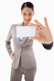 A cute businesswoman showing a blank business card Royalty Free Stock Photo